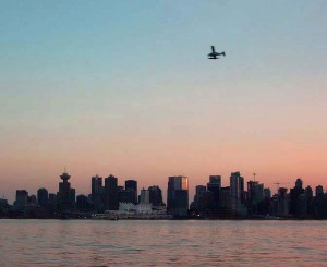 Vancouver City Skyline at Dusk with one of many float planes arriving.